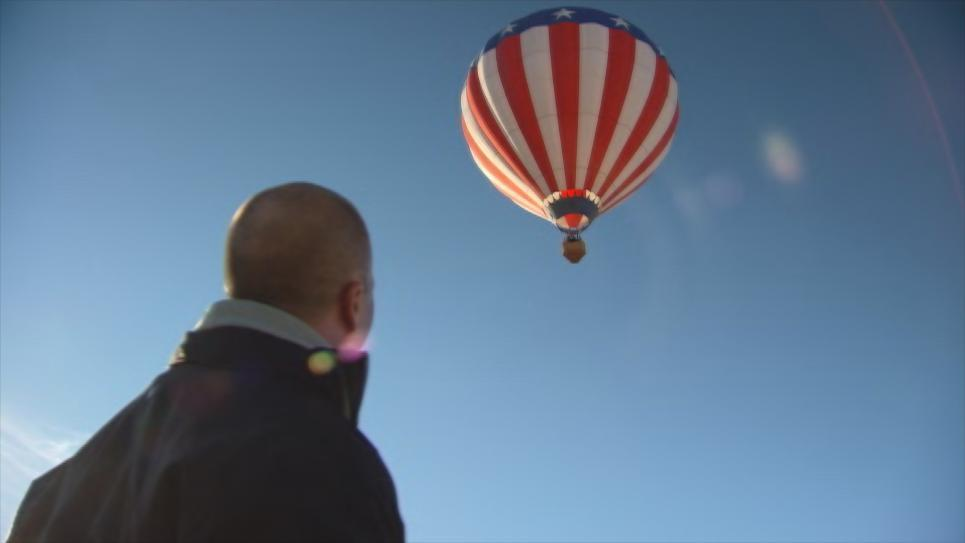 Steve watches Antonio and Kitty in air balloon