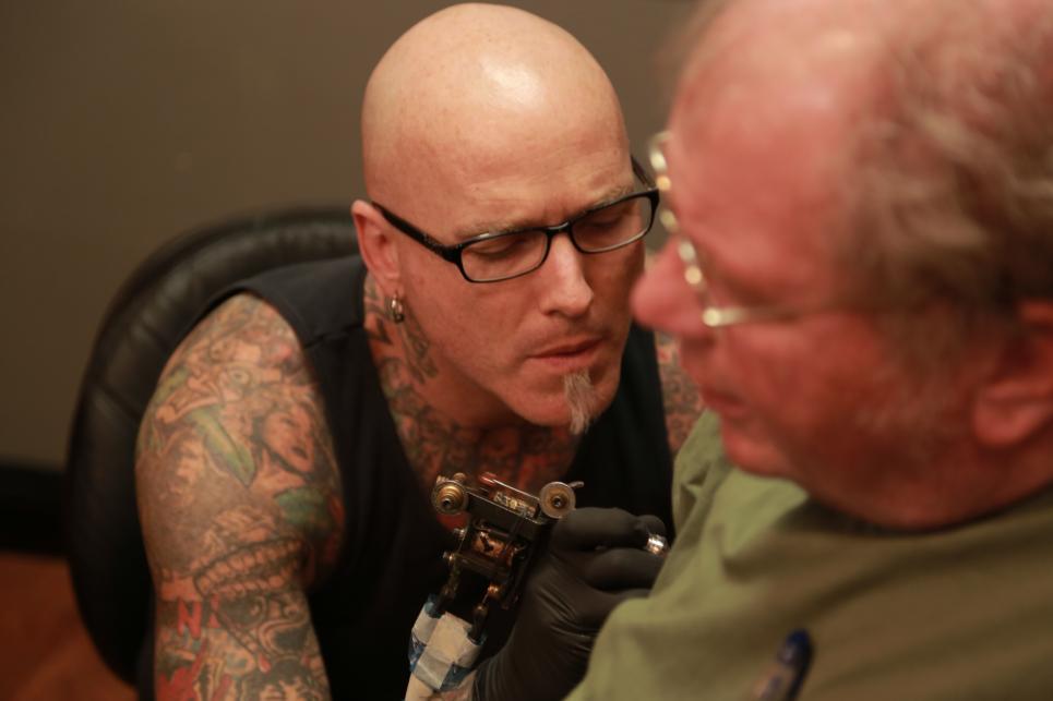 Dirk Works on Tim's Tattoo