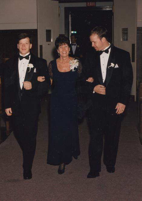 Paul and Donnie escort Alma to a wedding