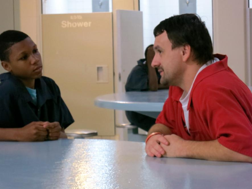 An inmate talks to Shafique.