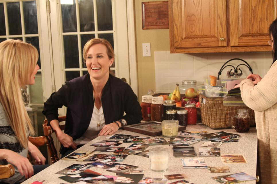 Korie Laughs at Old Family Photos