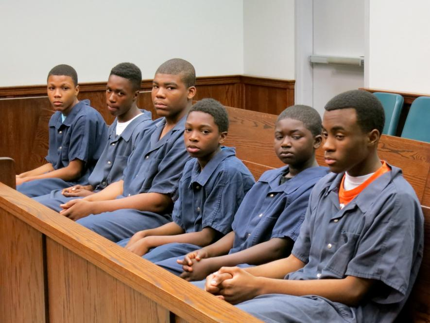 The teens wait in open court.