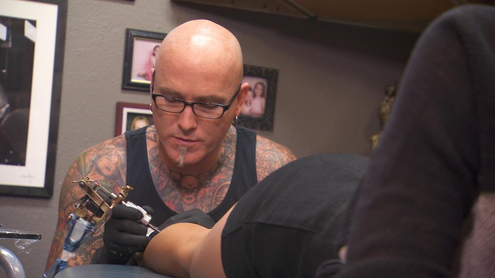Dirk Works on Brittney's Tattoo