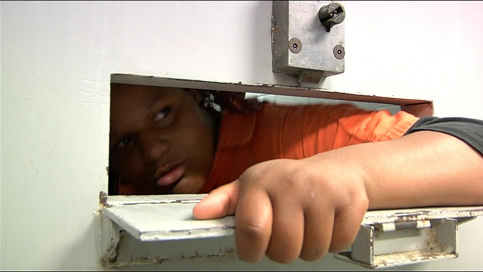 Tyonna despairs from inside a cell