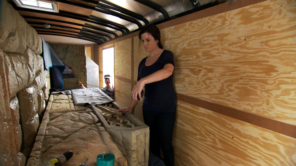Jennifer Packs the Bug Exhibit Into Her Trailer