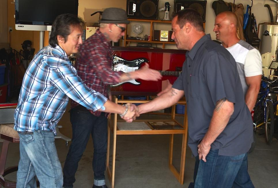 Ray and Dennis accept vintage guitar