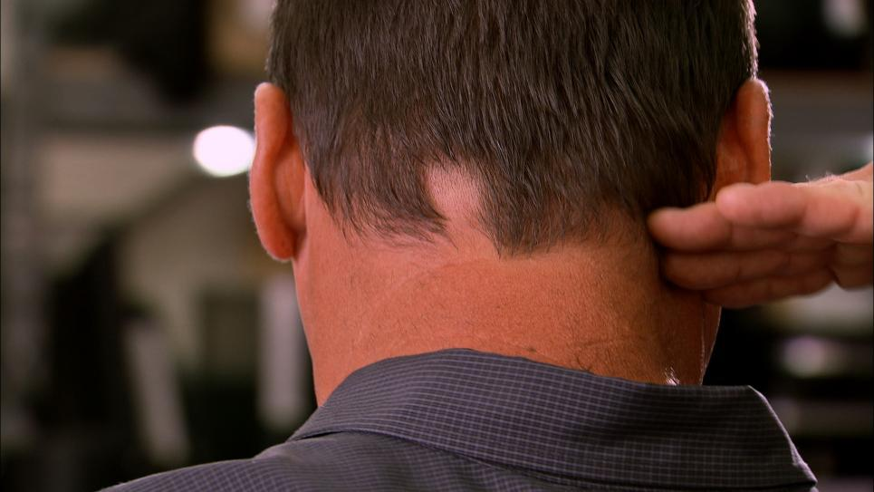 Steve cuts Antonio's hair