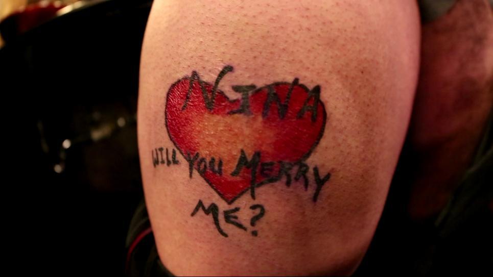 Alex is stuck with proposal tattoo