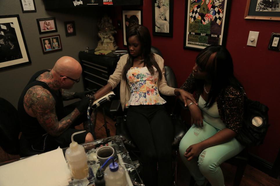 Dirk Works on Melissa's Tattoo
