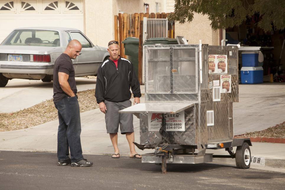 Steve examines a hotdog cart