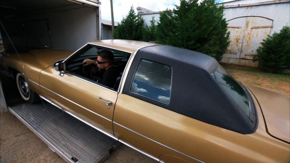 Chris loads Cadillac