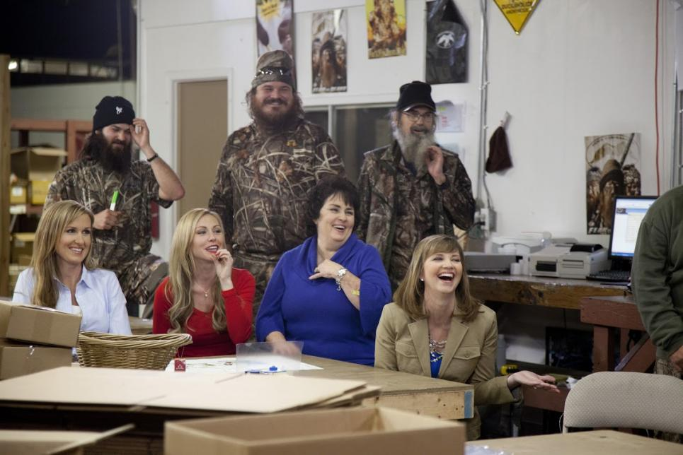 The Robertson family laughs together on Duck Dynasty.