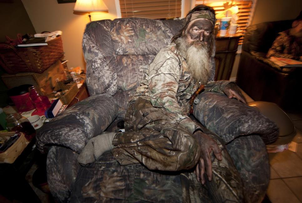 Phil relaxes on camo armchair