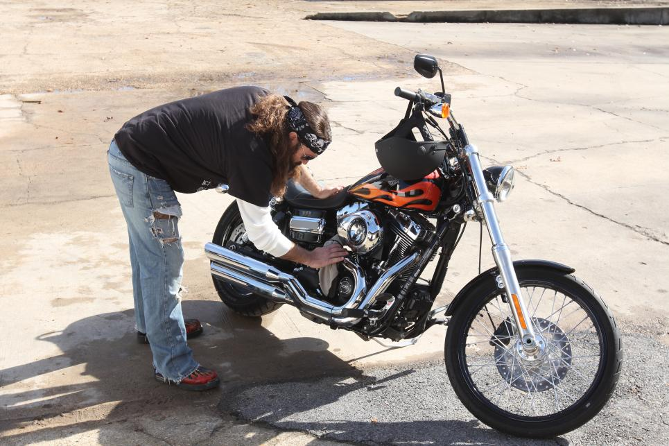 Willie Robertson wipes off new motorcycle