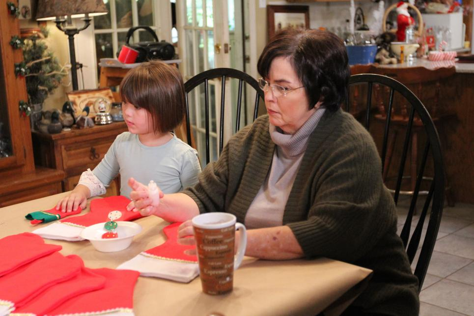 Kay and Priscilla Robertson decorate Christmas stockings