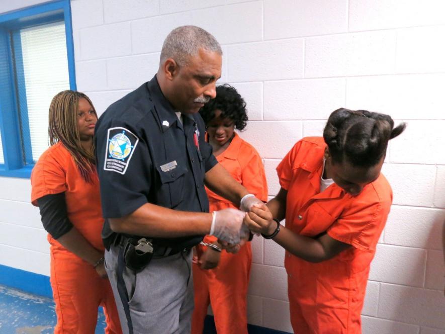 Ta-Ta resists handcuffs