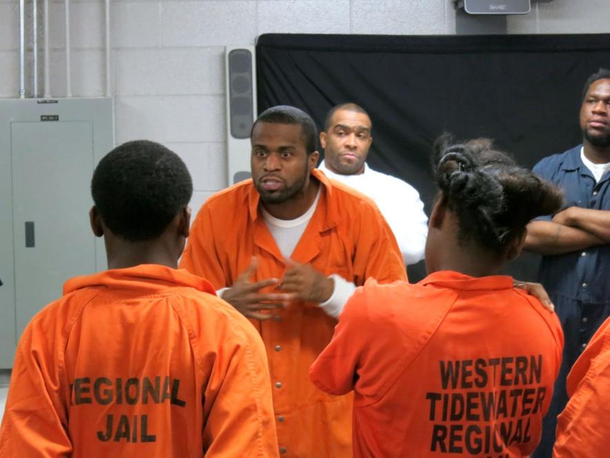 An inmate screams at the teens
