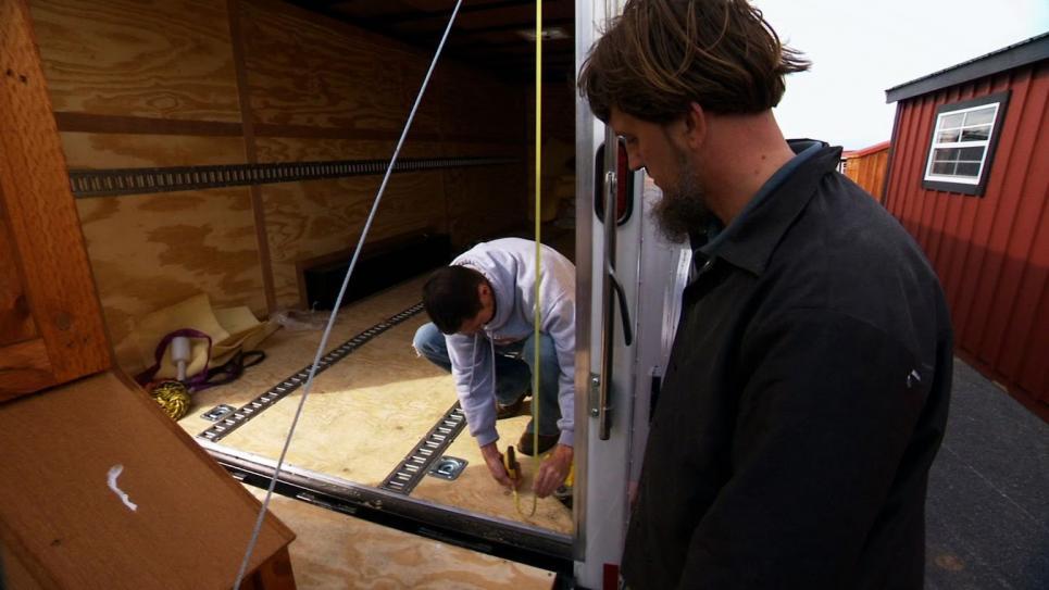 Jarrett measures trailer for chicken coops