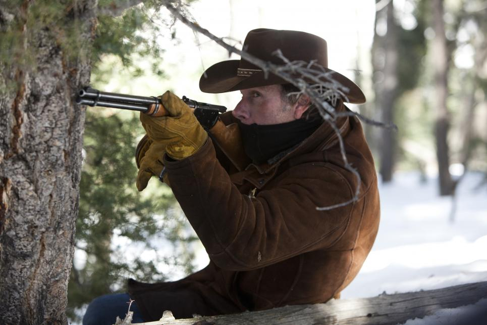Walt steadies rifle as bullets fly past him