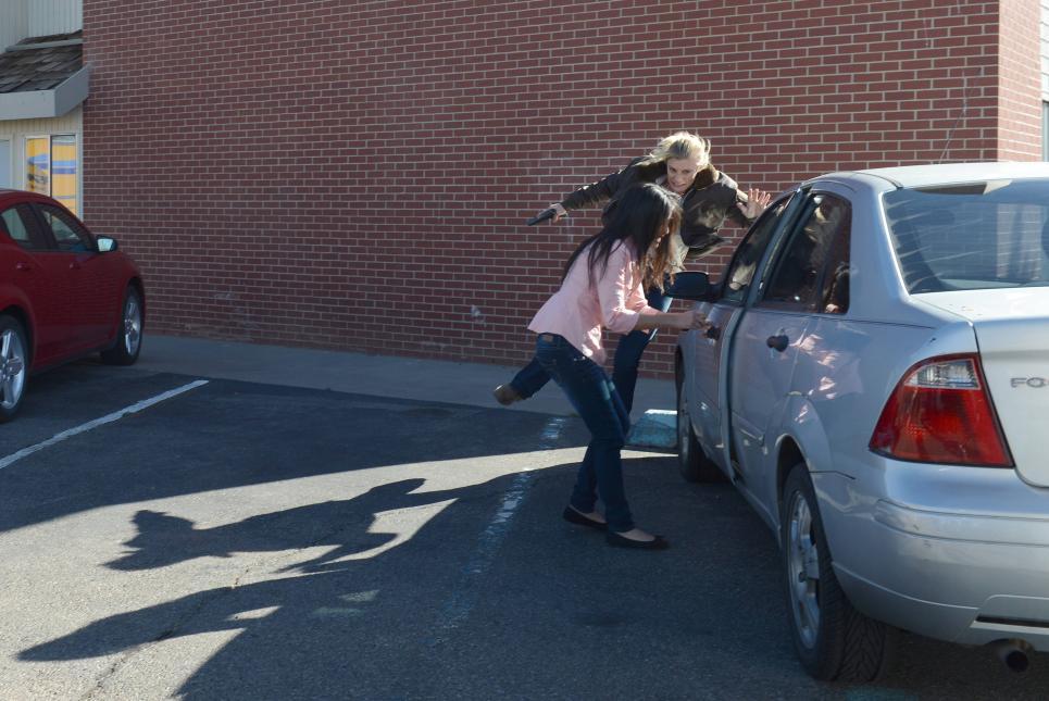 Vic hurls herself around Rosa's car
