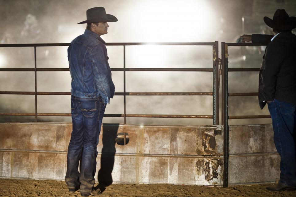 Branch watches bull riders