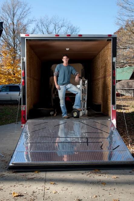Jarrett uses hand truck to load
