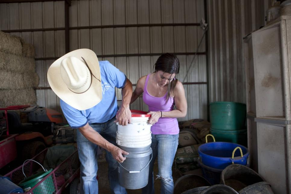 Jennifer and customer move feed buckets