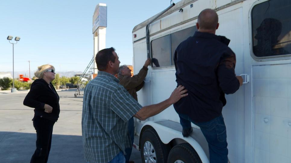 Antonio and Steve inspect horse trailer