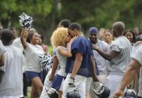 Murder suspect kisses girlfriend