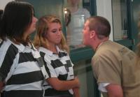 Inmate Alicia warns Sabrina and Kayla.