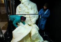 Jenn Helps Cut Apart Butter Statue