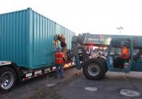 Marc Puts Shipping Container on Flatbed