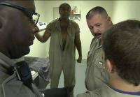 An inmate shocks Christian with the reality of jailhouse brutality