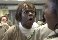 An inmate in the women's cell block approaches the teens with force