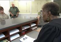 Judge Barbara Caldwell addresses Christian