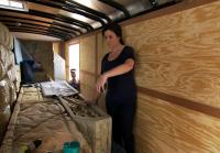 Jennifer Packs the Bug Exhibit Into Her Trailer