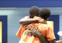 Shakial hugs his incarcerated brother goodbye