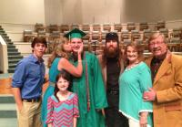 Missy Kisses Reed at Graduation