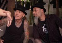 Dirk and Ruckus examine Jacqui's tattoo