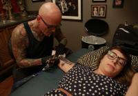 Dirk Works on Emily's Tattoo