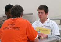 Clayton Talks With An Inmate