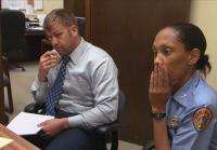 Detective Justin Rice sits with Detective Bianca Boone