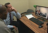 Detectives Greg Hamilton and Chuck Ward watch the interview