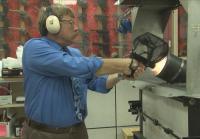 Detective James Kooser performs a ballistics test