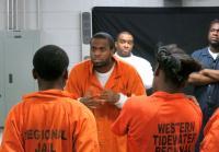 An inmate screams at the teens