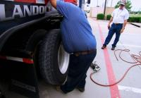Marc gets tire fixed