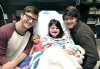 Reed and Cole with Mia in the Hospital