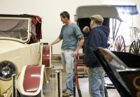 Jarrett Joyce inspects antique cars