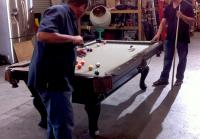 Steve and Antonio play pool at trading post