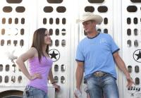 Jennifer talks to customer with rodeo bulls
